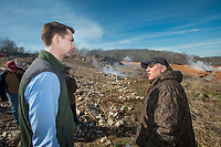NWA Democrat-Gazette/BEN GOFF @NWABENGOFF<br /> Kevin White (right), associate director of land resources with the Arkansas Department of Environmental Quality, leads U.S. Sen. Tom Cotton and other guests on a tour Friday, Feb. 8, 2019, at the stump dump fire site in Bella Vista.