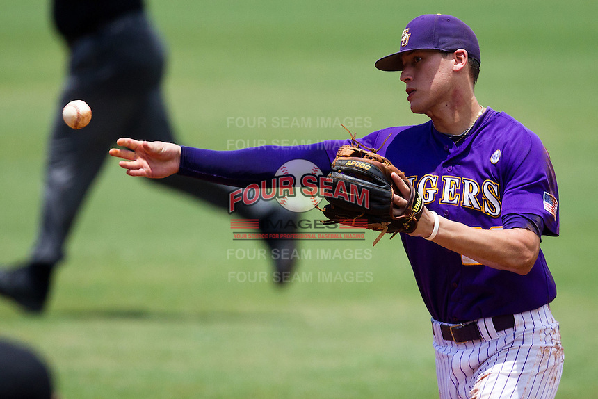 LSU Tigers second baseman Jacoby Jones #23 throws to first during the NCAA Super Regional baseball game against Stony Brook on June 9, 2012 at Alex Box Stadium in Baton Rouge, Louisiana. Stony Brook defeated LSU 3-1. (Andrew Woolley/Four Seam Images)