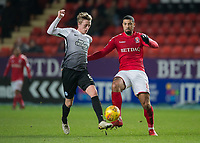 Leon Best of Charlton Athletic battles with Chris Forrester of Peterborough United during the Sky Bet League 1 match between Charlton Athletic and Peterborough at The Valley, London, England on 28 November 2017. Photo by Vince  Mignott / PRiME Media Images.