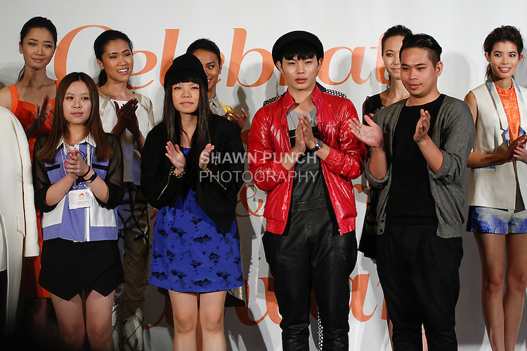 Taiwanese fashion designers from the PRAXES Taiwanese fashion incubation program, pose with models at the close of their fashion show, during the Celebrate Taiwan @ Grand Central Terminal event on September 28, 103.