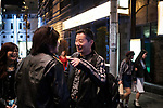 Freddy Lim (C) leader of Taiwanese Heavy Metal band called Chthonic and also lawmaker for New Power Party talks with a fan during an event in a bar in Tokyo on October 13, 2018. Taiwanese band organize a meet and greet event for the release of a new album. October 13, 2018 (Photo by Nicolas Datiche/AFLO) (JAPAN) JAPAN ONLY