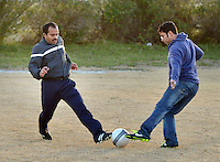STAFF PHOTO BEN GOFF  @NWABenGoff -- 12/25/14 Sudheesh Vasudevan, left, and Saju Sanjayan of Bentonville go after the ball while playing in a pickup soccer game at Memorial Park in Bentonville on Thursday Dec. 25, 2014.