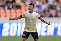 Houston, TX - Friday December 11, 2016: Jacori Hayes (8) of the Wake Forest Demon Deacons reacts to making his kick during the overtime shootout against the Stanford Cardinal at the NCAA Men's Soccer Finals at BBVA Compass Stadium in Houston Texas.