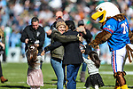 Family members reunited during the Armed Forces Bowl game between the Southern Mississippi Golden Eagles vs. Tulane Green Waves at the Amon G. Carter Stadium in Fort Worth, Texas.