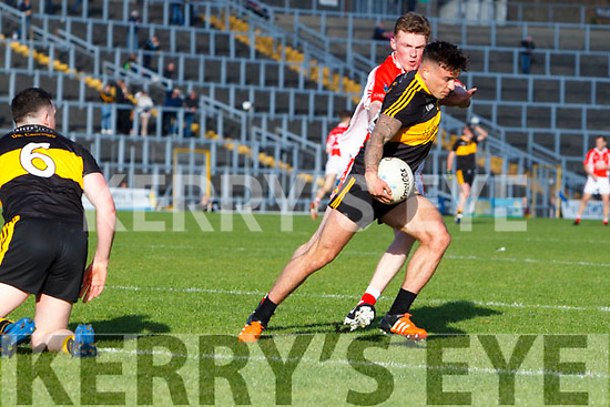 Micheál Burns Dr Crokes in action against Dara Ó Sé West Kerry in the Kerry Senior Football Championship Semi Final at Fitzgerald Stadium on Saturday.