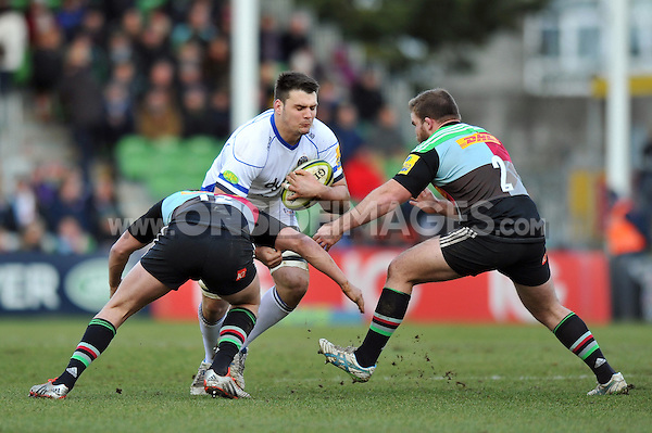 David Sisi of Bath Rugby takes on the Harlequins defence. LV= Cup match, between Harlequins and Bath Rugby on January 31, 2015 at the Twickenham Stoop in London, England. Photo by: Patrick Khachfe / Onside Images