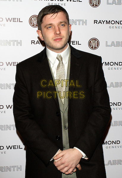 Ben Drew aka Plan B.Raymond Weil Pre Brits Dinner at Mozaica, Wood Green, London, England..January 26th 2012.half length black coat jacket grey gray tie suit white shirt.CAP/ROS.©Steve Ross/Capital Pictures