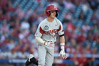 Casey Martin (15) of the Arkansas Razorbacks hustles down the first base line against the Oklahoma Sooners in game two of the 2020 Shriners Hospitals for Children College Classic at Minute Maid Park on February 28, 2020 in Houston, Texas. The Sooners defeated the Razorbacks 6-3. (Brian Westerholt/Four Seam Images)