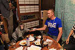 """October 22, 2016, Utsunomiya, Japan - A Japanese macaque Fuku (meaning happiness) gives a table napkin to a guest at an izakaya, Japanese pub """"Kayabuki"""" in Utsunomiya, 100km north of Tokyo on Saturday, October 22, 2016. The pub master Kaoru Otsuka trains Japanese macaques to help him and show their entertainment skills to attract customers including lots of foreign tourists.   (Photo by Yoshio Tsunoda/AFLO) LWX -ytd-"""