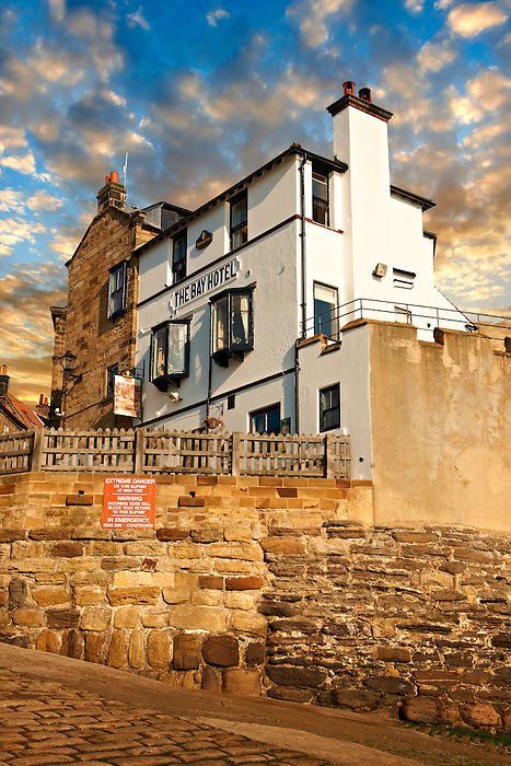 Bay Hotel & fishermans houses of the historic fishing village of Robin Hood's Bay, Near Whitby, North Yorkshire, England.