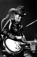 """Jan 1995 File photo of<br /> Blues & zydeco musician Clarence Gatemouth Brown, in concert at Cafe Campus in Montreal, Canada, January 1995<br /> <br /> Gate began his professional career at the age of 21 as a drummer in San Antonio. <br /> In 1947, Gate was in the audience at the Golden Peacock nightclub in Houston, when famed guitarist T-Bone Walker took sick and dropped his guitar onto the stage in the middle of a number. Gate leaped to the stage, picked up Walker's axe and laid into one of his own tunes, """"Gatemouth Boogie."""" T-Bone was not amused by the young upstart, but the crowd went wild, tossing $600 at Brown's feet in fifteen minutes. <br /> That stunt also got the attention of the club's owner, a Houston businessman named Don Robey. Robey hired Gate to play the club and eventually became his manager. He teamed Gate with a swinging 23-piece orchestra and booked him into venues across the South and Southwest. Gate made his first records for Hollywood's Alladin Records in 1947. When Alladin's promotion and release schedules didn't live up to expectations, Robey founded Peacock Records as an outlet for Gate's music. <br /> <br /> In 1971, he travelled to France for his debut tour of that country. During the '70s he toured Europe nearly a dozen times and recorded a total of nine European albums. <br /> In the mid-'70s, Gate became a spokesperson for American music, participating in a U.S. State Department sponsored tour of Eastern Africa, which included dates in Botswana, Lesotho, Zambia, Tanzania, Madagascar, Kenya, Sudan and Egypt. He became a fixture at the Montreux Jazz Festival in the late '70s, and in 1979 he toured the Soviet Union. <br /> <br />  <br /> (Photo by Pierre Roussel /images Distribution)"""