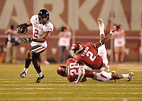 NWA Democrat-Gazette/MICHAEL WOODS • @NWAMICHAELW<br /> Texas Tech receiver Quan Shorts shakes Arkansas defenders Josh Liddell (28) and DJ Dean (2) as he runs for a big gain in the 4th quarter of Saturday nights game against Texas Tech at Razorback Stadium in Fayetteville.