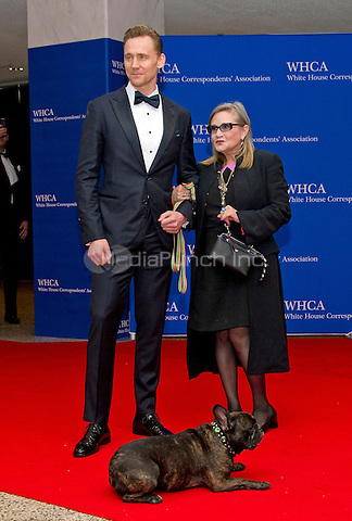 Actors Tom Hiddleston, left, and Carrie Fisher with her dog Gary arrive for the 2016 White House Correspondents Association Annual Dinner at the Washington Hilton Hotel on Saturday, April 30, 2016.<br /> Credit: Ron Sachs / CNP<br /> (RESTRICTION: NO New York or New Jersey Newspapers or newspapers within a 75 mile radius of New York City)/MediaPunch