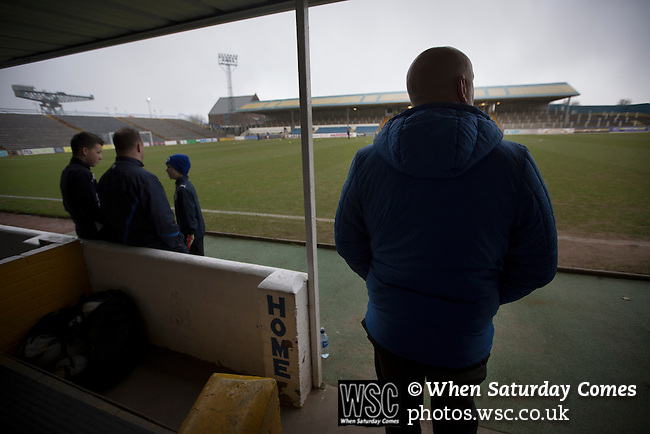 Greenock Morton 2 Stranraer 0, 21/02/2015. Cappielow Park, Greenock. Home team manager Jim Duffy (right) looking out over the pitch before Greenock Morton take on Stranraer in a Scottish League One match at Cappielow Park, Greenock. The match was between the top two teams in Scotland's third tier, with Morton winning by two goals to nil. The attendance was 1,921, above average for Morton's games during the 2014-15 season so far. Photo by Colin McPherson.