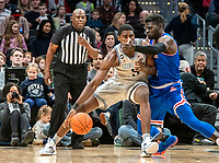 WASHINGTON, DC - DECEMBER 28: Josh Alexander #21 of American pushes into Timothy Ighoefe #5 of Georgetown. during a game between American University and Georgetown University at Capital One Arena on December 28, 2019 in Washington, DC.