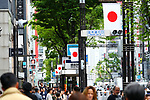People walk as Japanese flags are seen in Tokyo's Ginza shopping district, Japan on May 1, 2019, the first day of the Reiwa Era. (Photo by Naoki Nishimura/AFLO)