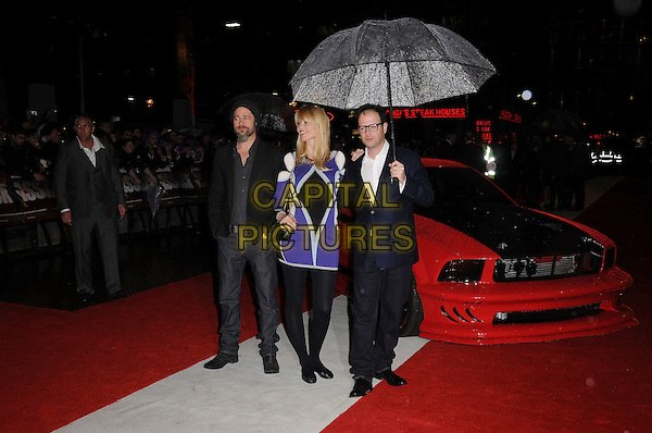 BRAD PITT, CLAUDIA SCHIFFER & MATTHEW VAUGHN .'Kick-Ass' UK film premiere.Empire cinema, Leicester Square, London, England, UK, 22nd March 2010.arrivals full length married couple husband wife vaughan pregnant black suit umbrella raining purple print dress bag patterned pattern gold chain strap tights ballet flats flat shoes glasses hand on shoulder maternity white shirt navy blue jacket hat beanie red car .CAP/CAS.©Bob Cass/Capital Pictures