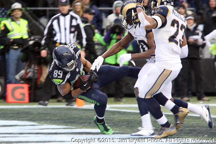 Seattle Seahawks wide receiver Doug Baldwin is hit by St. Louis Rams Lamarcus Joyner (20) after catching the ball for a touchdown at CenturyLink Field in Seattle, Washington on December 27, 2015.  The Rams beat the Seahawks 23-17.      ©2015. Jim Bryant Photo. All Rights Reserved