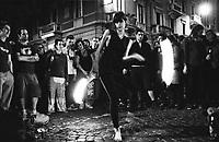 """Milano, un collettivo di """"Lavoratori dell'Arte e dello Spettacolo"""" occupa un edificio inutilizzato, la Torre Galfa, per dare vita a un nuovo centro per le arti e la cultura chiamato MACAO. Dopo 10 giorni avviene lo sgombero e gli attivisti occupano la strada di fronte. Una ragazza con le catene infuocate --- Milan, a collective of """"Arts and Entertainment Workers"""" occupy an unused building, the Galfa Tower, in order to create a new centre for arts and culture called MACAO. After 10 days police clears out the building and the activists occupy the street in front for several days long. A girl playing with fiery chains"""