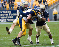 30 September 2006: Pitt linebackers Scott McKillop (left) and Steve Dell (6) rough up a Toledo ball carrier.  The Pitt Panthers defeated the Toledo Rockets 45-3 on September 30, 2006 at Heinz Field, Pittsburgh, Pennsylvania.
