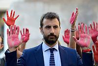 Roma, 24 Luglio 2018<br /> Erasmo Palazzotto.<br /> Decine di persone con le mani tinte di rosso a simboleggiare il sangue dei migranti morti in mare, protestano davanti Monte Citorio contro le politiche sull'immigrazione del Governo e del Ministro Salvini