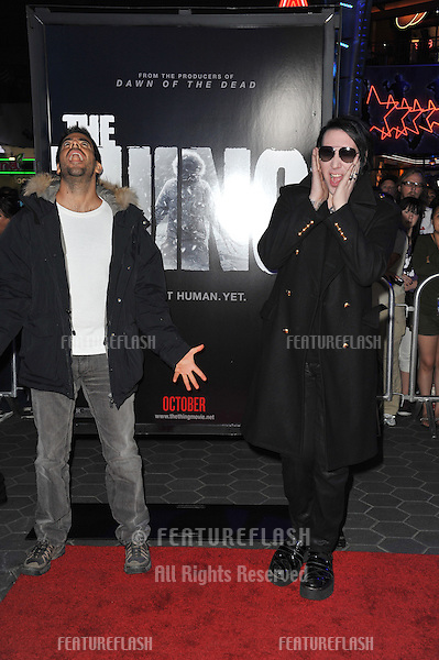 "Eli Roth (left) & Marilyn Manson at the world premiere of ""The Thing"" at Universal Studios Hollywood..October 10, 2011  Los Angeles, CA.Picture: Paul Smith / Featureflash"