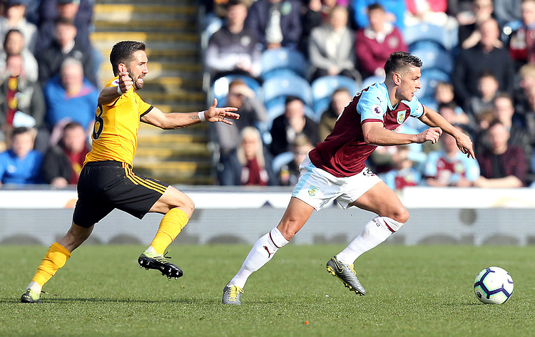 Burnley's Ashley Westwood gets away from Wolverhampton Wanderers' Joao Moutinho<br /> <br /> Photographer Rich Linley/CameraSport<br /> <br /> The Premier League - Burnley v Wolverhampton Wanderers - Saturday 30th March 2019 - Turf Moor - Burnley<br /> <br /> World Copyright © 2019 CameraSport. All rights reserved. 43 Linden Ave. Countesthorpe. Leicester. England. LE8 5PG - Tel: +44 (0) 116 277 4147 - admin@camerasport.com - www.camerasport.com