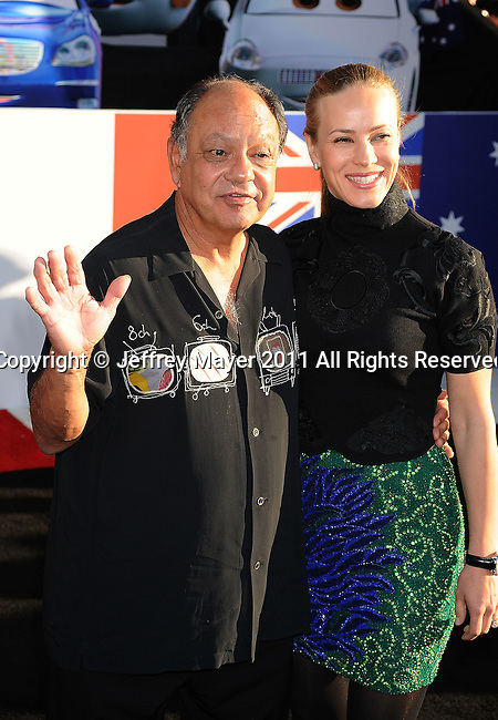 """HOLLYWOOD, CA -JUNE 18: Cheech Marin and wife attend the """"Cars 2"""" Los Angeles Premiere at the El Capitan Theatre on June 18, 2011 in Hollywood, California."""