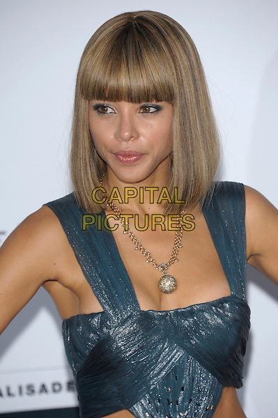 ANA ARAUJO.amfAR's Cinema Against AIDS Gala during the 64th Annual Cannes Film Festival at Hotel Du Cap, Antibes, France, May 19th, 2011..half length blue grey gray dress sleeveless top fringe bangs hair necklace beauty .CAP/PL.©Phil Loftus/Capital Pictures