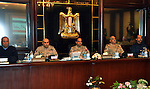 Egypt's army chief Field Marshal Abdel Fattah al-Sisi (C) attends a meeting with Egypt's army chief of staff Lieutenant General Sedki Sobhi at Egypt's military council headquarters in Cairo January 27, 2014. Egypt's top military council gave Sisi a green light on Monday to seek election as president, a vote he is almost sure to win with Egyptians weary of turmoil unleashed by a pro-democracy uprising in 2011. apaimages/Egypt Ministry of Defence