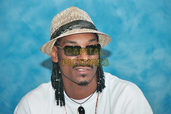 SNOOP DOGG.headshot, portrait, hat, braids, plaits, sunglasses, shades, mustache, goatee, facial hair.www.capitalpictures.com.sales@capitalpictures.com.© Capital Pictures.