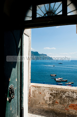 View from an arched doorway to the sea, in the village of Atrani, on the Amalfi Coast, Italy