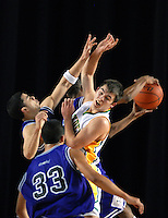Lynden High School's Brady Bomber competes for a defensive rebound against several Foster High School players during the first round of the Washington 2A state tournament at the Tacoma Dome in Tacoma, Wash. on Wednesday, March 7, 2007. Lynden beat Foster, 54-40, and will advance to play Chehalis W.F. West in the second round of the tournament on Thursday.