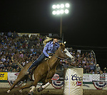 Kaillee Hamre from Los Molinos, CA competes in the Barrel Racing event during Wolf Pack Night at the Reno Rodeo on Wednesday, June 22, 2016.
