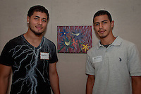 German Valdez-Botello (on right) poses with his brother, Roberto, in front of his artwork on display at The von Liebig Art Center.  The von Liebig and Ringling College of Art and Design awarded $8,000 in college scholarships to seven Collier County high school juniors and seniors on Friday, April 15, 2011. Photo by Debi Pittman Wilkey
