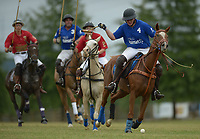 NWA Democrat-Gazette/ANDY SHUPE<br /> John Hand (right) strikes the ball Saturday, Sept. 8, 2018, as he charges to the goal ahead of Kim Mayer during the 29th annual Polo in the Ozarks at the Buell Farm in Goshen. This event features a polo match, games, vendors, music and food to benefit Life Styles Inc.