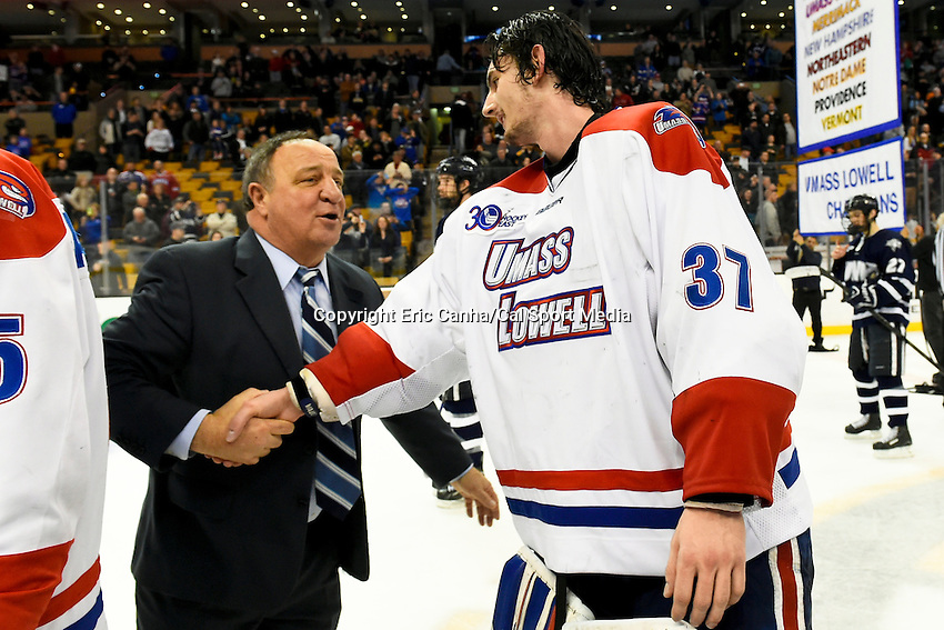 March 22, 2014 - Boston, Massachusetts , U.S. - University of New Hampshire's Head Coach Dick Umile congratulates UMass Lowell's Connor Hellebuyck (37) at the NCAA Hockey East tournament championship game between the University of Massachusetts  and the University of New Hampshire at TD Garden in Boston Massachusetts. UMass defeated UNH 4-0. Eric Canha/CSM