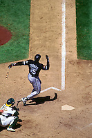 OAKLAND, CA - Frank Thomas of the Chicago White Sox bats during a game against the Oakland Athletics at the Oakland Coliseum in Oakland, California in 1994. (Photo by Brad Mangin)