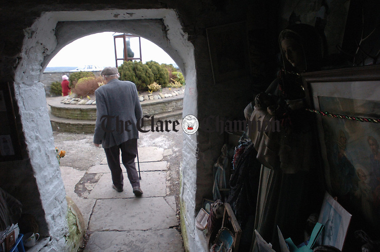 "The Grotto visited, an elderly man begins the ""rounds"" at St Brigids Well, Liscannor on the feast day of St Brigid. Photograph by John Kelly."
