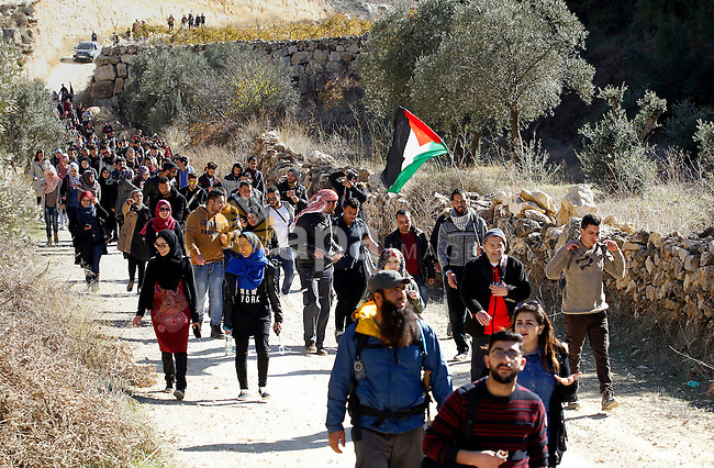 """Palestinians take part in the walking tour titled """"eyes Tavouh"""" in the village of Tavouh in the northwest the West bank city of Hebron on the December 31, 2016. Photo by Wisam Hashlamoun"""