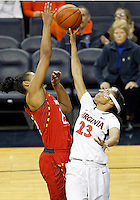 Virginia guard Ataira Franklin (23) battles for the rebound with Maryland forward Alyssa Thomas (25) during the game Thursday in Charlottesville, VA. Photo/The Daily Progress/Andrew Shurtleff