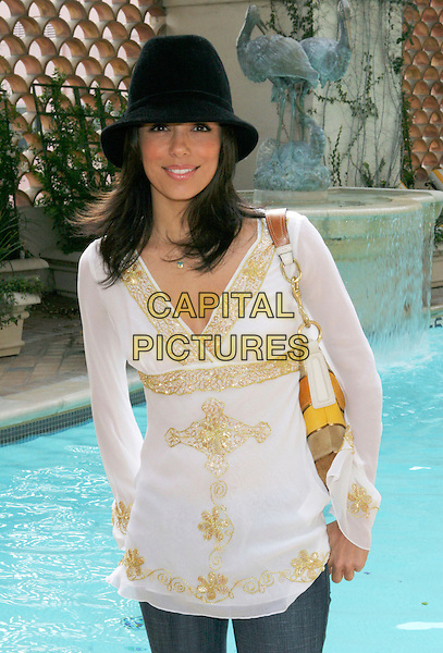 "EVA LONGORIA.""World Style 2005""  Pre Oscar Retreat at The Regent Beverly Wilshire Hotel, Beverly Hills, California, USA,.25 February 2005..half length hat gold tunic floaty top cream white embroidered patterned jeans pool.Ref: ADM.www.capitalpictures.com.sales@capitalpictures.com.©ZLipp/AdMedia/Capital Pictures ."
