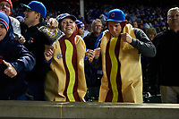 Chicago Cubs fans wearing hot dog costumes after Game 5 of the Major League Baseball World Series against the Cleveland Indians on October 30, 2016 at Wrigley Field in Chicago, Illinois.  (Mike Janes/Four Seam Images)