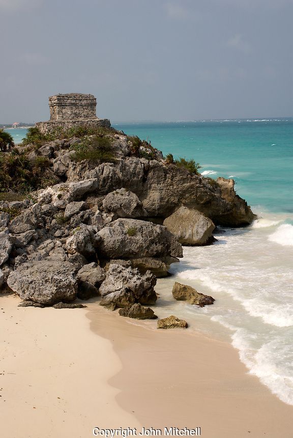 Temple of the Wind God and beach at the Mayan ruins of Tulum on the Riviera Maya, Quintana Roo, Mexico..