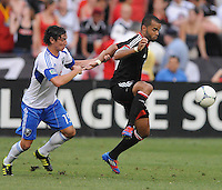 D.C. United forward Maicon Santos (29) goes against Montreal Impact defender Zarek Valentin (19) D.C. United defeated Montreal Impact 3-0 at RFK Stadium, Saturday June 30, 2012.