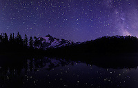 Panorama of Milky Way rising by Mount Shuksan with stars reflected in Picture Lake. North Cascades National Park and Mount Baker - Snoqualmie National Forest respectively.