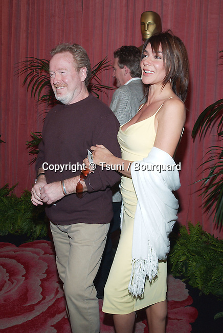 """Nominee for Best Director for """"Blackhawk Down"""", Ridley Scott and date arrive at the nominees luncheon for the 74th Annual Academy Awards at the Beverly Hilton Hotel in Beverly Hills, Ca., March 11, 2002.            -            ScottRidley01A.jpg"""