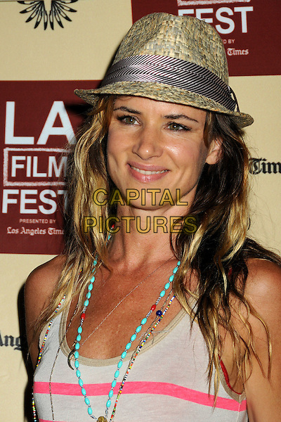 """Juliette Lewis.2011 Los Angeles Film Festival Screening of """"Beats, Rhymes & Life: The Travels Of A Tribe Called Quest"""" held at the John Anson Ford Amphitheatre, Los Angeles, California, USA, .24th June 2011..portrait headshot  necklace hat smiling  turquoise beads pink grey gray vest .CAP/ADM/BP.©Byron Purvis/AdMedia/Capital Pictures."""