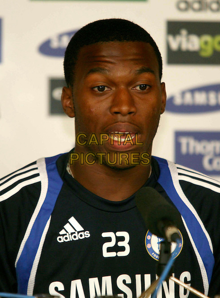 DANIEL STURRIDGE.Press conference with new Chelsea manager, Carlo Ancelotti, presenting new signing, Daniel Sturridge, at the Cobham training ground, Cobham, Surrey, England..July 9th, 2009 .headshot portrait blue black mouth open.CAP/DS.©Dudley Smith/Capital Pictures