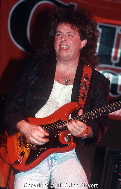 Steve Lukather, Jan 1989, Los Angeles. American Grammy Award-winning guitarist, singer, songwriter, arranger, and record producer best known for his work with the rock band Toto. Lukather has played with countless artists, released several solo albums and, as a studio session guitarist, has been involved with arranging, composing, and recording on over 1,000 albums.<br /> <br /> He is also a member of jazz fusion bands El Grupo and Los Lobotomys, both collaborations of notable sessions musicians. While his work with Toto was predominantly based on pop rock music, Lukather's solo and side-project work spans many genres including rock, prog, jazz and funk.